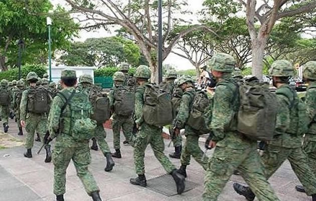 The Ministry of Defence (MINDEF) is reportedly considering structured fitness training for National Service pre-enlistees who fail to achieve a silver standard for their National Physical Fitness Award (NAPFA) a year before enlistment. (Yahoo photo)