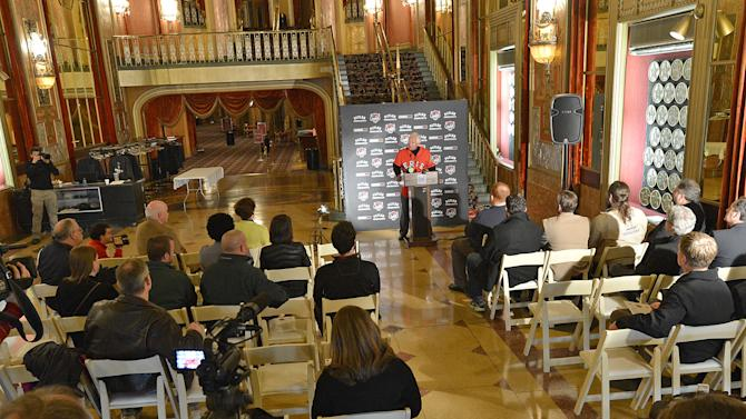 Fernando Aguirre, at podium, announces  that he's buying the Erie SeaWolves, a Class AA baseball affiliate of the Detroit Tigers, and plans to keep the team in Erie, during a news conference, Friday, March 27, 2015 at the Warner Theatre in Erie, Pa. (AP Photo/Erie Times-News, Christopher Millette)