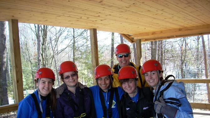 This photo courtesy of the McGhee Family, members of Boy Scouts Venture Crew 1893 from Charleston, W.Va., are shown in a 2012 photo during a zipline trip at Adventures on the Gorge in Fayetteville, W.Va. In front, from left to right, are Perry McGhee, Haley Breeden, Noor Malik, Ally Ugland and Virginia McGhee. In the back is John McGhee. For the first time, Venture crew members will be allowed to participate in the Boy Scouts' National Jamboree, which takes place in mid-July in southern West Virginia. (AP Photo, Kelly McGhee)(AP Photo/McGhee Family)