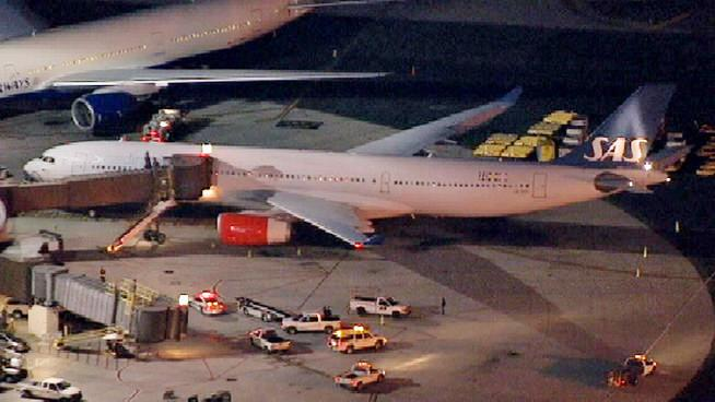 In this image taken from video and provided by television station WNBC-TV, a damaged SAS Airbus A330 sits on the tarmac at New Liberty International Airport after clipping the wing of another aircraft on takeoff, Wednesday, May 1, 2013 in Newark, N.J. Federal Aviation Administration officials say no one was injured in the incident at about 7:30 p.m. (AP Photo/WNBC-TV) MANDATORY CREDIT