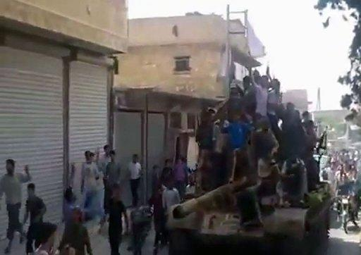 A YouTube video shows crowds greeting Syrian rebels as they parade through a street in Al-Bab in the province of Aleppo