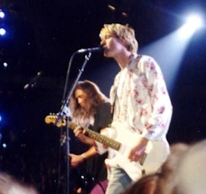 Kurt Cobain (front) and Krist Novoselic (left) live at the 1992 MTV Video Music Awards.
