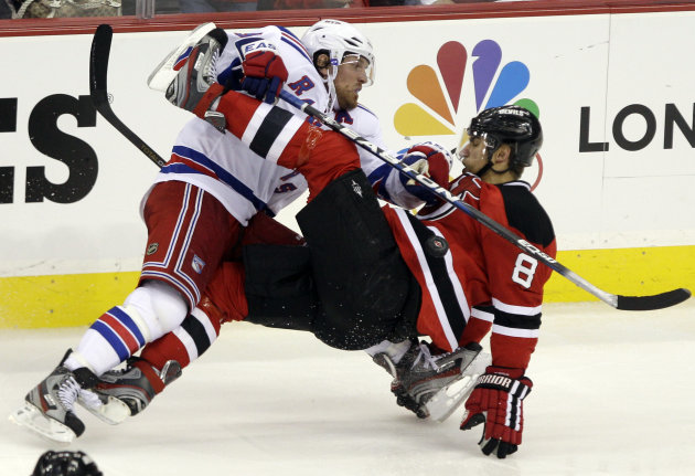New York Rangers center Brad Richards, left, collides with New Jersery Devils defenseman Dainius Zubrus, of Lithuania, during the second period of Game 3 of an NHL hockey Stanley Cup Eastern Conference final playoff series Saturday, May 19, 2012, in Newark, N.J. (AP Photo/Frank Franklin II)