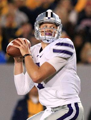Kansas State quarterback Collin Klein looks to pass during an NCAA college football game against West Virginia in Morgantown, W.Va., Saturday, Oct. 20, 2012. Kansas State won 55-14. (AP Photo/Christopher Jackson)