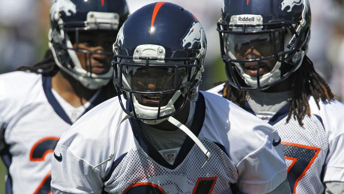 Denver Broncos defensive back Champ Bailey runs with the football during NFL football practice at the team's training facility in Englewood, Colo., on Monday, June 4,  2012. (AP Photo/Ed Andrieski)