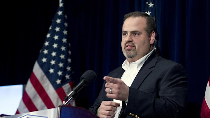 Mark Mattioli the father of a child killed during the Sandy Hook Elementary School shooting, gestures during a news conference at the National Press Club in Washington, Tuesday, April 2, 2013, where he talked about the National School Shield Task Force program. The National School Shield program is a frame work to arm security guards in any school system who want to be part of the program. (AP Photo/Jose Luis Magana)