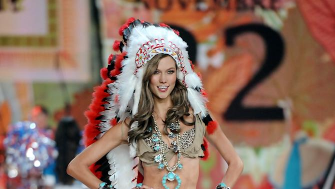 FILE - This Nov. 7, 2012 file photo shows model Karlie Kloss wearing an Indian headdress during the 2012 Victoria's Secret Fashion Show in New York. Victoria Secret has apologized for putting a replica of a Native American headdress on a model for its annual fashion show. The company responded to criticism over the weekend by saying it was sorry to have upset anyone and would not include the outfit in the show's television broadcast next month. (Photo by Evan Agostini/Invision/AP, file)