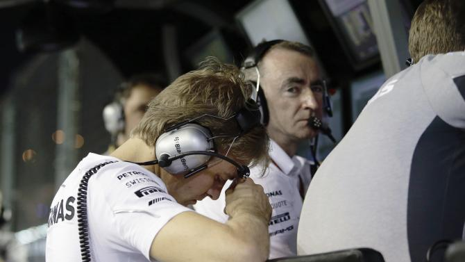Mercedes Formula One driver Rosberg of Germany reacts next to the team's Technical Executive Director Lowe at the pitwall during the Singapore F1 Grand Prix in Singapore