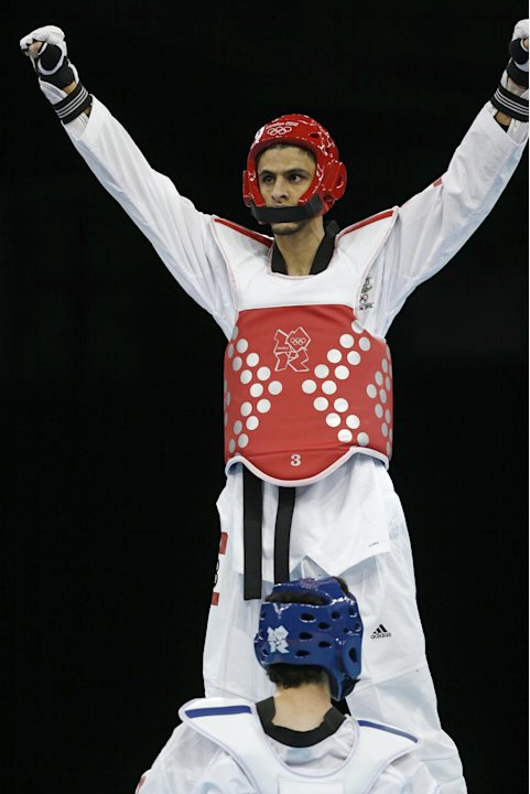 Australia's Safwan Khalil, top, reacts after his fight against Mexico's Diego Garcia de Leon in men's 58-kg taekwondo competition at the 2012 Summer Olympics, Wednesday, Aug. 8, 2012, in London. (AP P