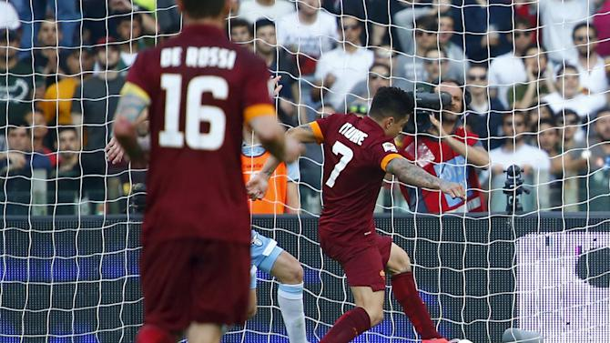 AS Roma's Iturbe shoots and scores during their Serie A soccer match against Lazio at the Olympic stadium in Rome