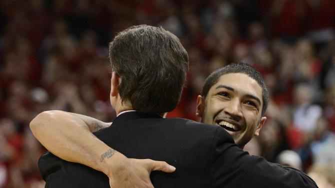 Louisville's Peyton Siva, right, hugs head coach Rick Pitino following their 73-57 victory over Notre Dame in an NCAA college basketball game Saturday March 9, 2013 in Louisville, Ky.  (AP Photo/Timothy D. Easley)