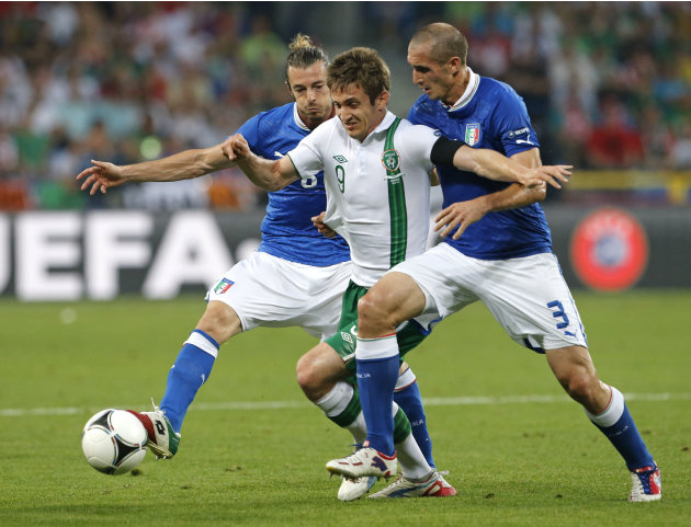 Italy's Federico Balzaretti, left, Ireland's Kevin Doyle, center, and Italy's Giorgio Chiellini go for the ball during the Euro 2012 soccer championship Group C match between Italy and the Republic of