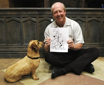 Garfield creator Jim Davis (II) shows a drawing of Odie to the movie Odie in 20th Century Fox's Garfield: A Tail of Two Kitties
