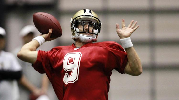 New Orleans Saints quarterback Drew Brees (9) works out during the first practice of NFL football training camp at their indoor training facility in Metairie, La., Thursday, July 26, 2012. (AP Photo/Gerald Herbert)