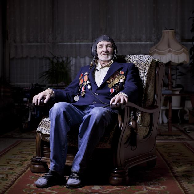 In this photo made Thursday, April 18, 2013, Soviet Jewish World War Two veteran Nahum Matovich, 87, poses for a portrait at his house in the southern Israeli city of Ashkelon. Mativich was an air for