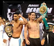Britain&#39;s Amir Khan (L) and American Danny Garcia at the official weigh-in on July 13 in Las Vegas. Khan and undefeated Garcia meet in a light-welterweight title unification showdown on Saturday with each fighter seeking a victory to launch him to another level