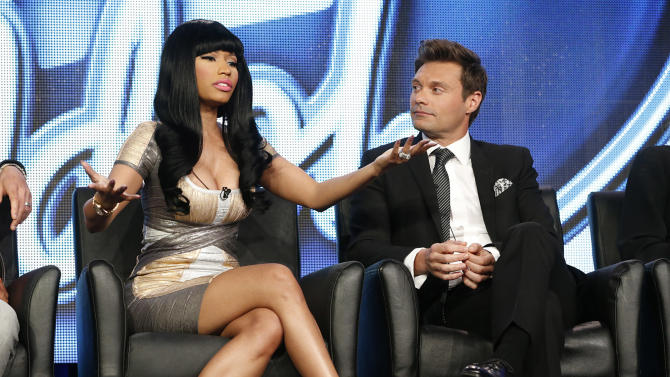 "Nicki Minaj and Ryan Seacrest from ""American Idol"" attend the Fox Winter TCA Tour at the Langham Huntington Hotel on Tuesday, Jan. 8, 2013, in Pasadena, Calif. (Photo by Todd Williamson/Invision/AP)"