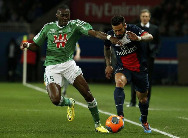 St Etienne's Guilavogui challenges Paris St Germain's Lavezzi during their French Ligue 1 soccer match at the Parc des Princes Stadium in Paris