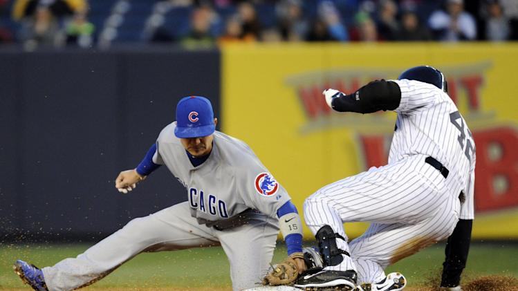 New York Yankees' Carlos Beltran, right, slides into second with a double as Chicago Cubs' Darwin Barney applies the late tag during the first inning of Game 2 of an interleague baseball doubleheader on Wednesday, April 16, 2014, at Yankee Stadium in New York