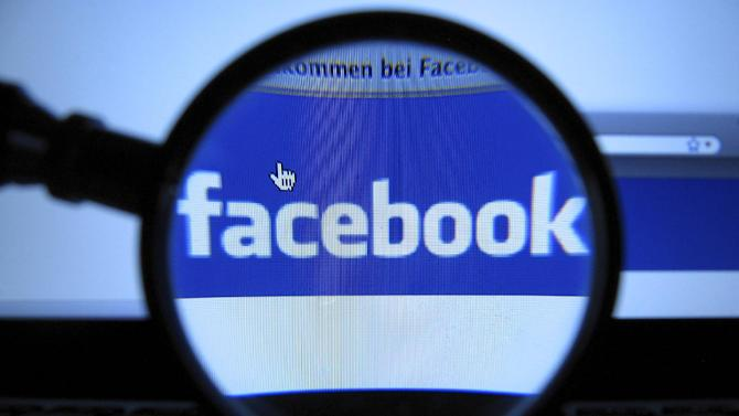 FILE - This Oct. 11, 2010 file photo, shows the logo of the online network Facebook, recorded in Munich with a magnifying glass of a computer screen of a laptop. Facebook said Tuesday, Nov. 29, 2011, it is settling with the Federal Trade Commission over charges it deceived consumers. The FTC had charged that the social network told people they could keep the information they share private and then allowed for it to be made public. The charges go back to 2009.(AP Photo/dapd, Joerg Koch)