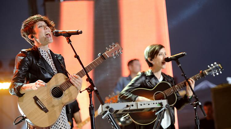 Tegan Quin, left, and Sara Quin, of musical group Tegan and Sara, perform at the mtvU Woodie Awards on Thursday, March 14, 2013, in Austin, Texas. (Photo by Scott Gries/Invision for MTV/AP Images)