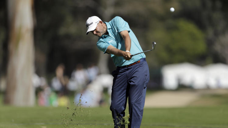 Bill Haas makes his approach shot on the 13th fairway in the third round of the Northern Trust Open golf tournament at Riviera Country Club in the Pacific Palisades area of Los Angeles, Saturday, Feb. 16, 2013. (AP Photo/Reed Saxon)