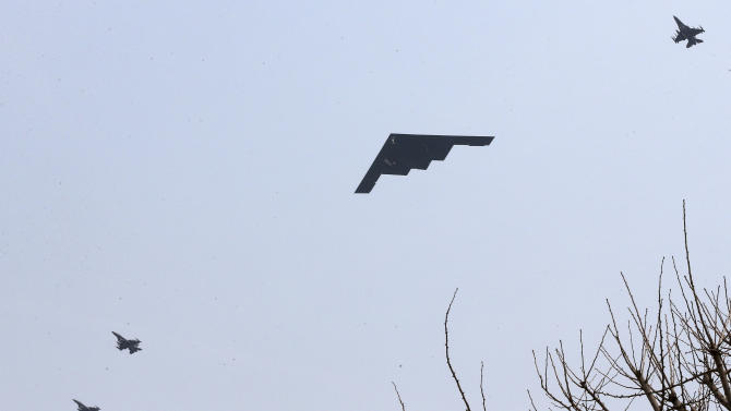 U.S. Air Force B-2 stealth bomber flies over near Osan U.S. Air Base in Pyeongtaek, south of Seoul, South Korea, Thursday, March 28, 2013. A day after shutting down a key military hotline, Pyongyang instead used indirect communications with Seoul to allow South Koreans to cross the heavily armed border and work at a factory complex that is the last major symbol of inter-Korean cooperation. (AP Photo/Shin Young-keun, Yonhap) KOREA OUT