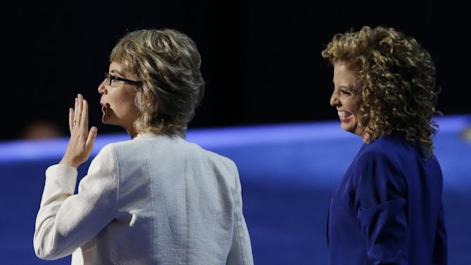 Former Rep. Gabrielle Giffords, left, blows kisses with Democratic National Committee Chairwoman Rep. Debbie Wasserman Schultz, from Florida, to recite the Pledge of Allegiance the Democratic National Convention in Charlotte, N.C., on Thursday, Sept. 6, 2012. (AP Photo/Lynne Sladky)