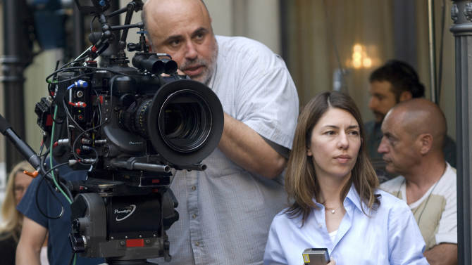 """FILE - In this film publicity file image released by Focus Features, Director of photography Harris Savides, left, and director Sofia Coppola work on the set of """"Somewhere.""""  Savides, an acclaimed cinematographer who worked frequently with Gus Van Sant and David Fincher, died Wednesday night, Oct. 10, 2012, his representatives at The Skouras Agency confirmed Thursday. He was 55. (AP Photo/Focus Features, Franco Biciocchi, File)"""