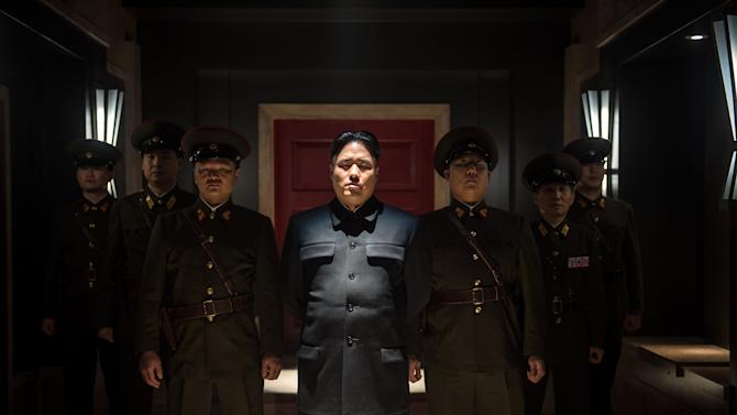 "This photo provided by Columbia Pictures - Sony shows, Randall Park, center, as North Korean leader Kim Jong Un in Columbia Pictures' ""The Interview."" North Korea has been linked to the unprecedented act of cyberwarfare against Sony Pictures that exposed tens of thousands of sensitive documents and escalated to threats of terrorist attacks that ultimately drove the studio to cancel all release plans for ""The Interview."" (AP Photo/Columbia Pictures - Sony, Ed Araquel)"