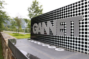 Gannett corporate sign: Credit AP