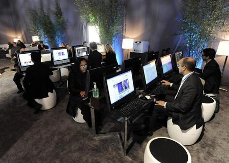 Attendees surf the internet at the Milken Institute Global Conference in Beverly Hills
