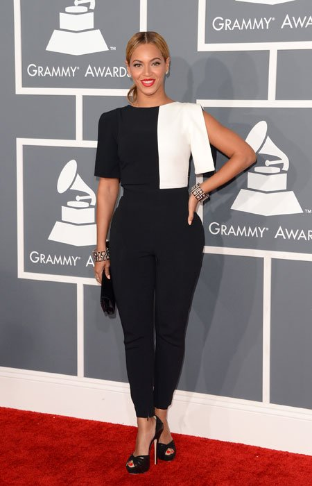 It seems that Beyonc is taking the infamous Grammy memo to heart. The sexy Superbowl halftime singer surprises everyone by covering up her curves in a black and white colour block pantsuit. We hope t
