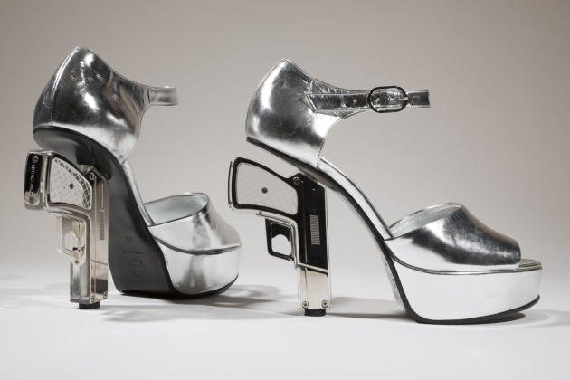 "In this undated photo provided by the Fashion Institute of Technology shows a pair of silver shoes designed by Chanel with guns as heels. The shoe is on display at the ""Shoe Obsession"" exhibit at The"