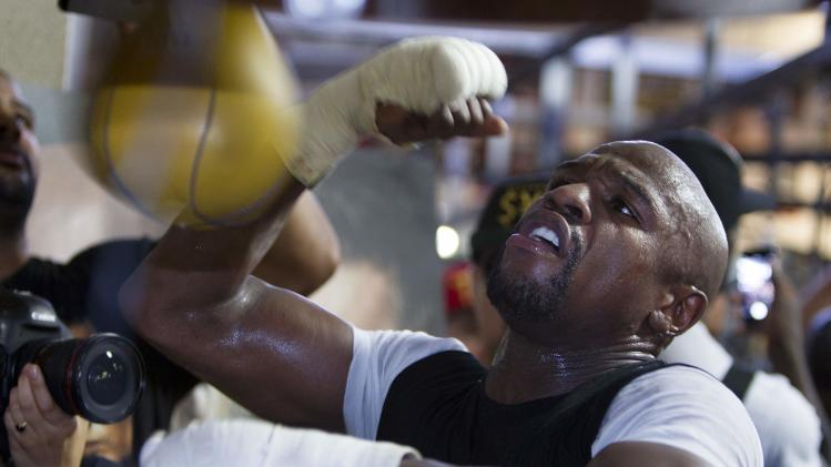 WBC/WBA welterweight champion Floyd Mayweather Jr. of the U.S. hits a speedbag during a media day at the Mayweather Boxing Club in Las Vegas