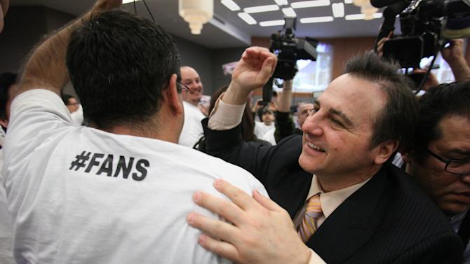 Gavin Maloof, co-owner of the Sacramento Kings, celebrates after the  Sacramento City Council approved a plan to help finance a new $391 sports and entertainment arena, in Sacramento, Calif. Tuesday, March 6, 2012.  By a 7-2 vote, the City Council approved a non-binding term sheet, signed off by the Kings and the NBA last week, that will keep the team in Sacramento for at least another 30 years. (AP Photo/Rich Pedroncelli)