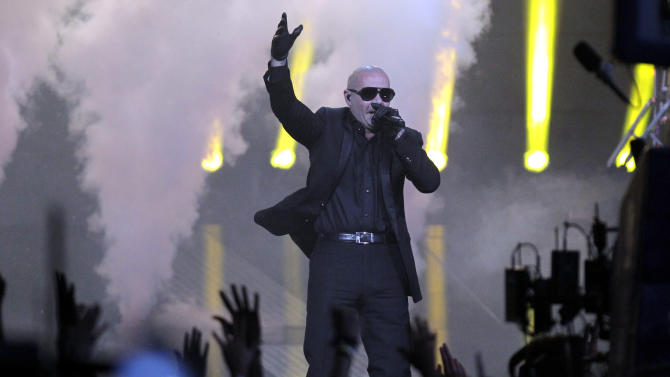 """FILE - In this Feb. 26, 2012 file photo, rapper Pitbull performs during the half time show of the NBA All-Star basketball game, in Orlando, Fla. Pitbull will be coming to Alaska. Over the last few weeks, Walmart has been running a marketing contest on its Facebook page. The store that got the most """"likes"""" wins a personal appearance from Pitbull, aka Miami rapper Armando Christian Perez. A writer for The Boston Phoenix newspaper thought it'd be funny to send Pitbull to the most remote Walmart possible, and encouraged people to pick the Walmart in Kodiak _ which wound up with more than 70,000 """"likes."""" (AP Photo/Chris O'Meara, file)"""