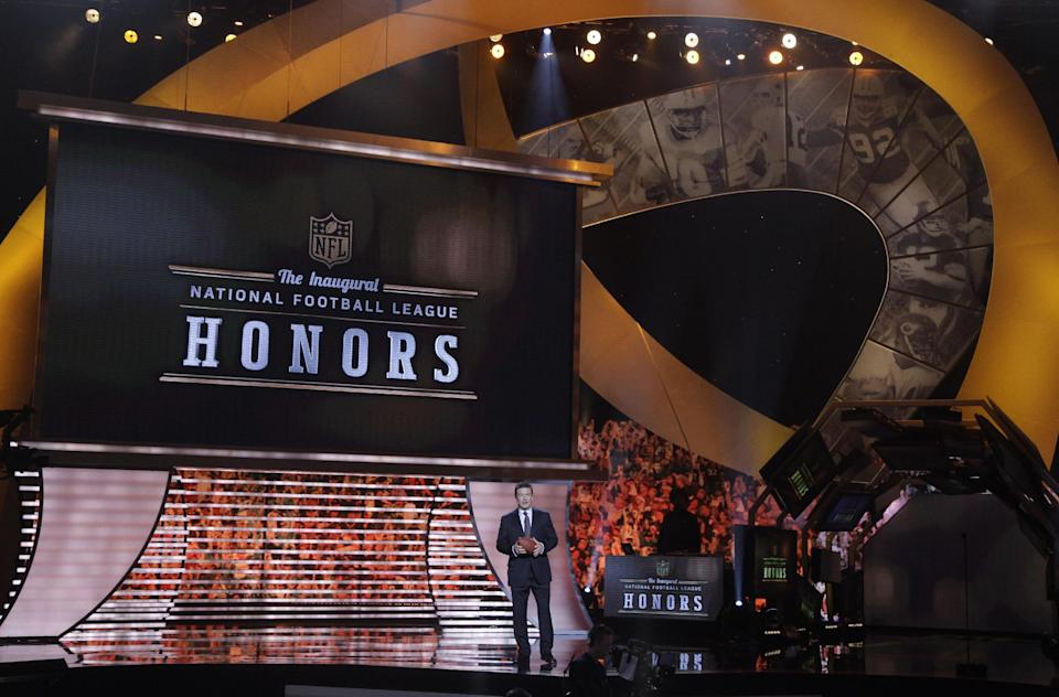 Host Alec Baldwin speaks during the inaugural NFL Honors show Saturday, Feb. 4, 2012, in Indianapolis.The New York Giants will face the New England Patriots in the NFL football's Super Bowl XLVI in Indianapolis on Feb. 5. (AP Photo/Marcio Sanchez)
