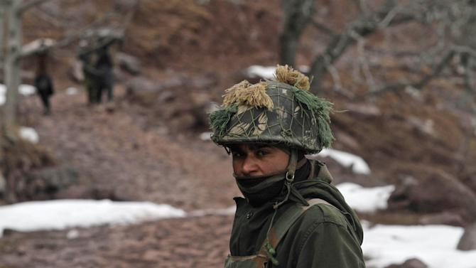 "An Indian army soldier patrols near the Line of Control (LOC), the line that divides Kashmir between India and Pakistan, in Churunda village, about 150 Kilometers (94 miles) northwest of Srinagar, India, Tuesday, Jan. 15, 2013. India's relations with archrival Pakistan ""cannot be business as usual"" in the wake of a spate of attacks in Kashmir, Prime Minister Manmohan Singh said Tuesday in a statement that threatens to ratchet up tensions in the wake of the Himalayan violence. A series of tit-for-tat attacks, including the beheading of an Indian soldier, across the LOC that divides the Himalayan region has killed two Pakistani and two Indian soldiers over the past 10 days. (AP Photo/Mukhtar Khan)"
