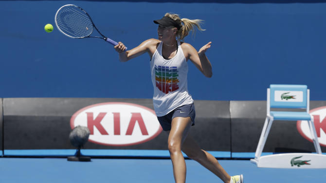 Russia's Maria Sharapova makes a forehand return during a practice session at Melbourne Park during her preparation for next week's Australian Open tennis championship in Melbourne, Australia, Thursday, Jan. 10, 2013. (AP Photo/Mark Baker)
