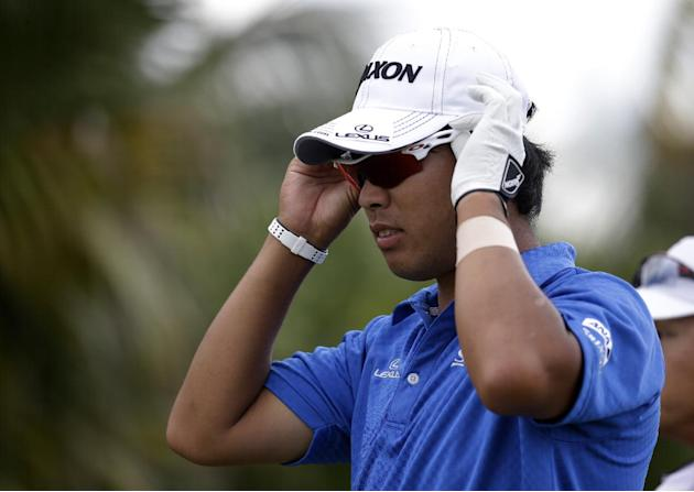 Hideki Matsuyama of Japan puts on his sunglasses during the final round of the Cadillac Championship golf tournament Sunday, March 9, 2014, in Doral, Fla. (AP Photo/Lynne Sladky)