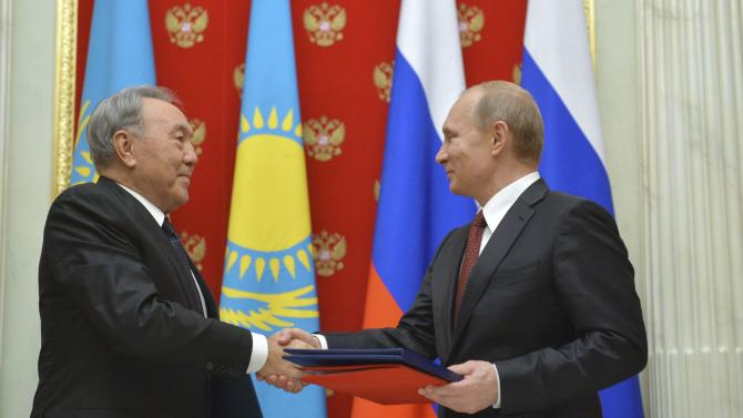 Russian President Vladimir Putin meets with his Kazakh counterpart Nursultan Nazarbayev at the Kremlin in Moscow