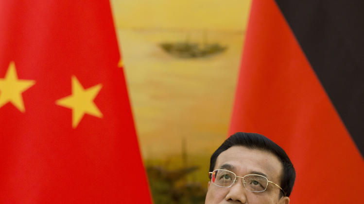 Growth in China has failed to accelerate in the second quarter, but the nation's leaders such as  Chinese Premier Li Keqiang, shown here in Beijing on July 7, 2014, say slower growth is good for the country