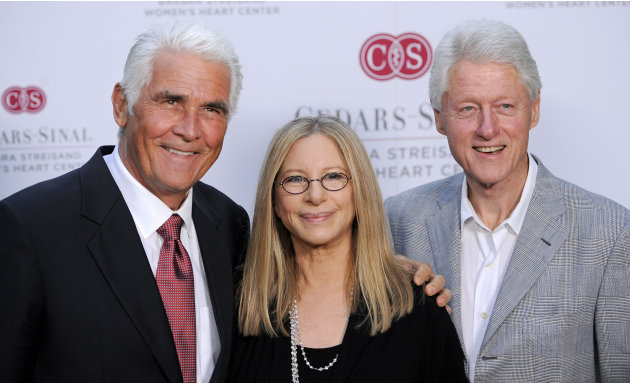 Former President Bill Clinton, right, poses with Barbra Streisand, center, and her husband James Brolin at the dedication of the Barbra Streisand Women's Heart Center in the Cedars-Sinai Heart Institu