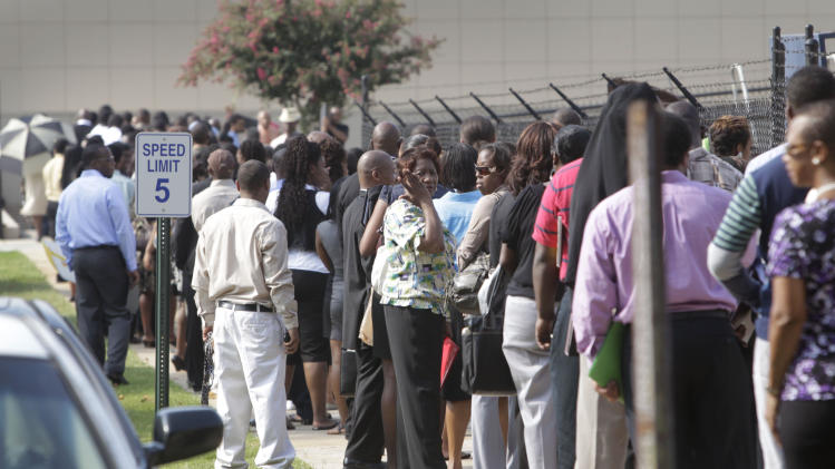 People wait in line during a job fair, sponsored by the Congressional Black Caucus, Thursday, Aug. 18, 2011 on the campus of Atlanta Technical College in Atlanta. (AP Photo/Atlanta Journal & Constitution, Bob Andres)  MARIETTA DAILY OUT; GWINNETT DAILY POST OUT