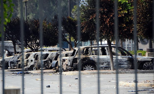 View of several dozen burned cars in the parking lot of the U.S. Embassy, a day after several thousand demonstrators angry over a film that insults the Prophet Muhammad stormed the compound, Tunis, Tunisia, Saturday, Sept. 15, 2012. Tunisia&#39;s governing moderate Islamist party condemned an attack on the U.S. Embassy in Tunis and the neighboring American school, saying Saturday that such violence threatens the country&#39;s progress toward democracy after decades of dictatorship. (AP Photo/Hassene Dridi)