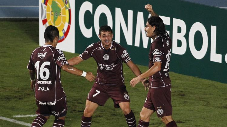 Acosta of Lanus celebrates scoring a goal against Deportivo Cali during Copa Libertadores match in Cali
