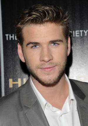 "Actor Liam Hemsworth attends a special screening of ""The Hunger Games"" hosted by The Cinema Society and Calvin Klein Collection at SVA Theatre on Tuesday, March 20, 2012 in New York. (AP Photo/Evan Agostini)"
