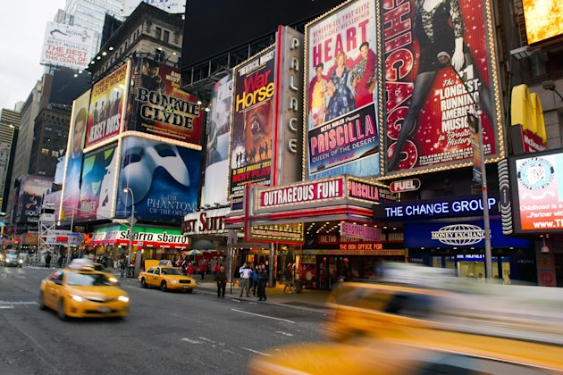 FILE - This Jan. 19, 2012 file photo shows billboards advertising Broadway shows in Times Square, in New York. The TEDxBroadway conference will be held Monday, Jan. 28, 2013, at the off-Broadway complex New World Stages. The one-day event is bringing together more than a dozen producers, marketers, entrepreneurs, academics, economists and artists. All will try to answer the question: &quot;What is the best Broadway can be?&quot; (AP Photo/Charles Sykes, file)
