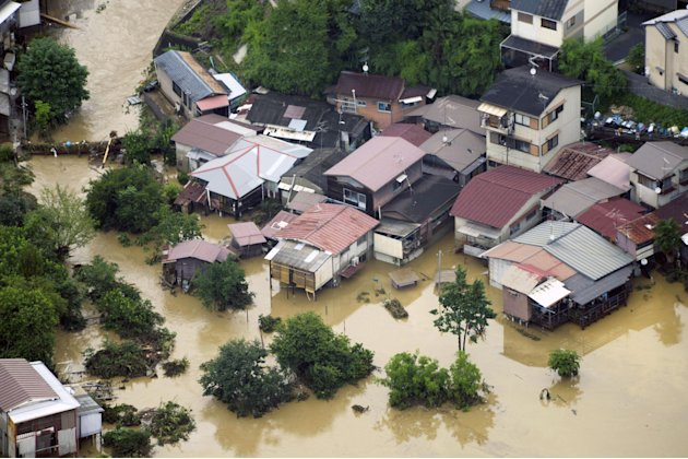 A residential area is submerged by a torrential rain overnight in Kyoto, western Japan, Sunday, July 15, 2012. Heavy rain triggered flash floods in western Japan after days of rains caused heavy damag